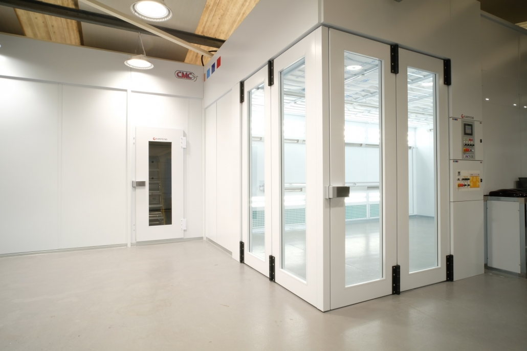 Hybrid infrared booth with corner entry doors